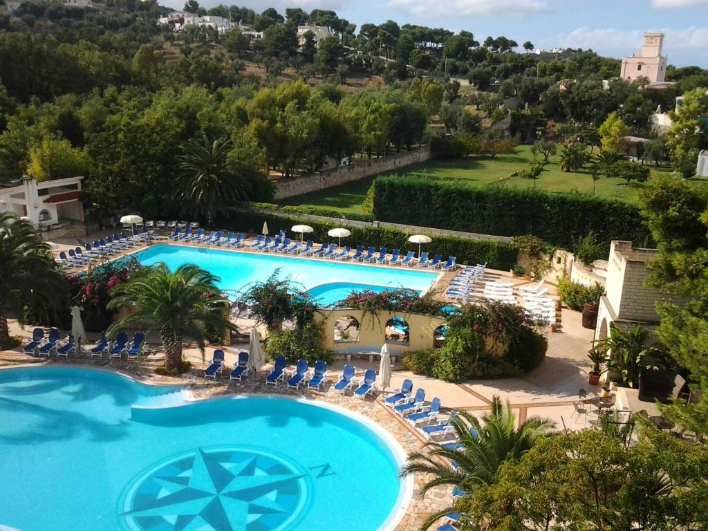 A view of the pool at Baia Degli Aranci Camping Village or nearby