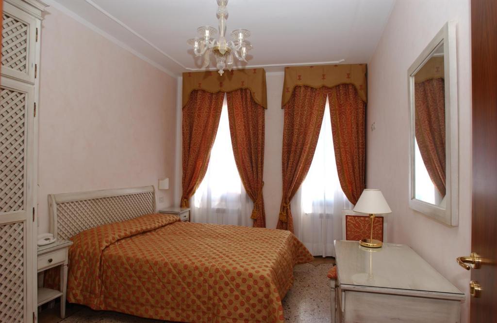 Ein Bett oder Betten in einem Zimmer der Unterkunft Casa Mimma