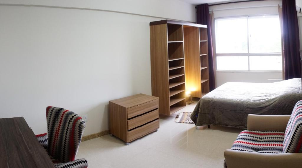 A bed or beds in a room at Apartamento Condomínio Hilka