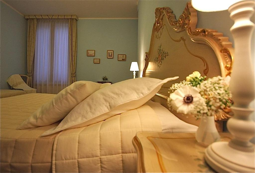 Cama ou camas em um quarto em Residenza Al Pozzo