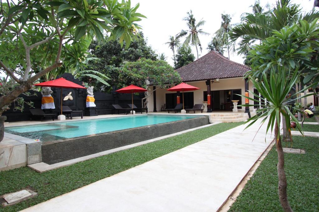 The swimming pool at or near Hotel Melamun