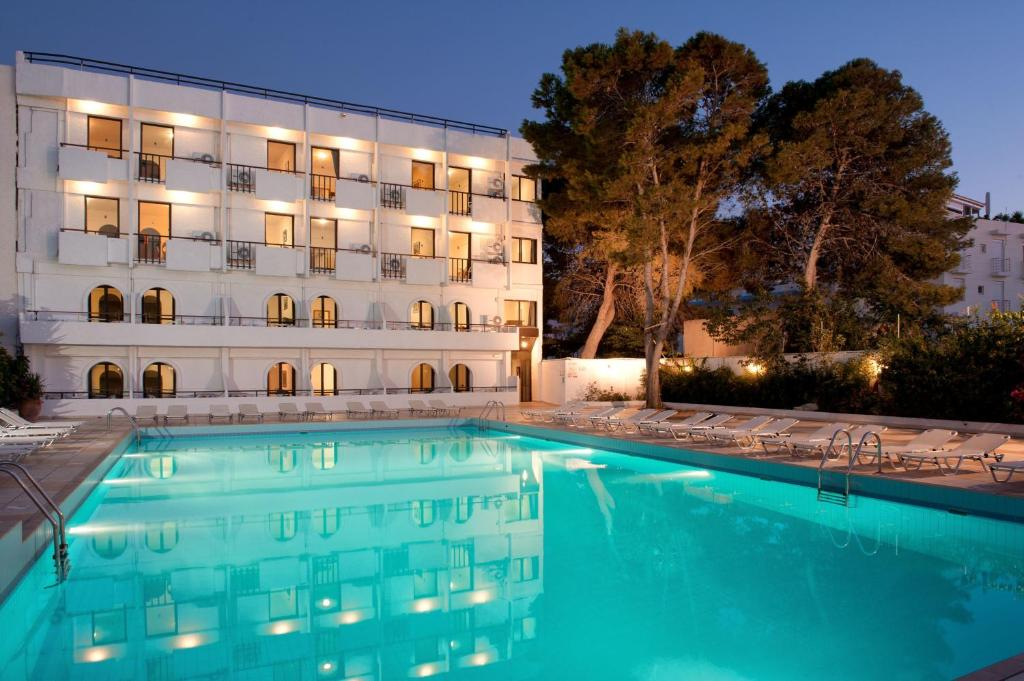 The swimming pool at or near Heronissos Hotel