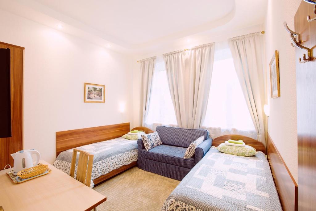 Кровать или кровати в номере Апарт-Отель Пушкарев