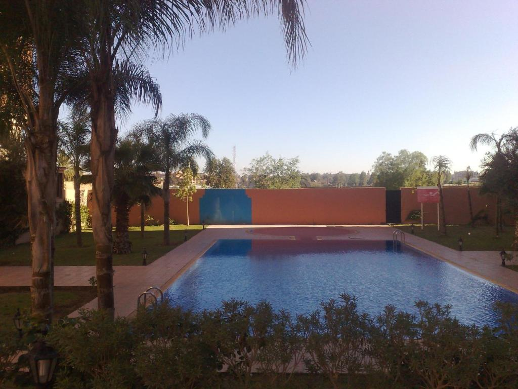 The swimming pool at or near Appartement Elias Marrakech