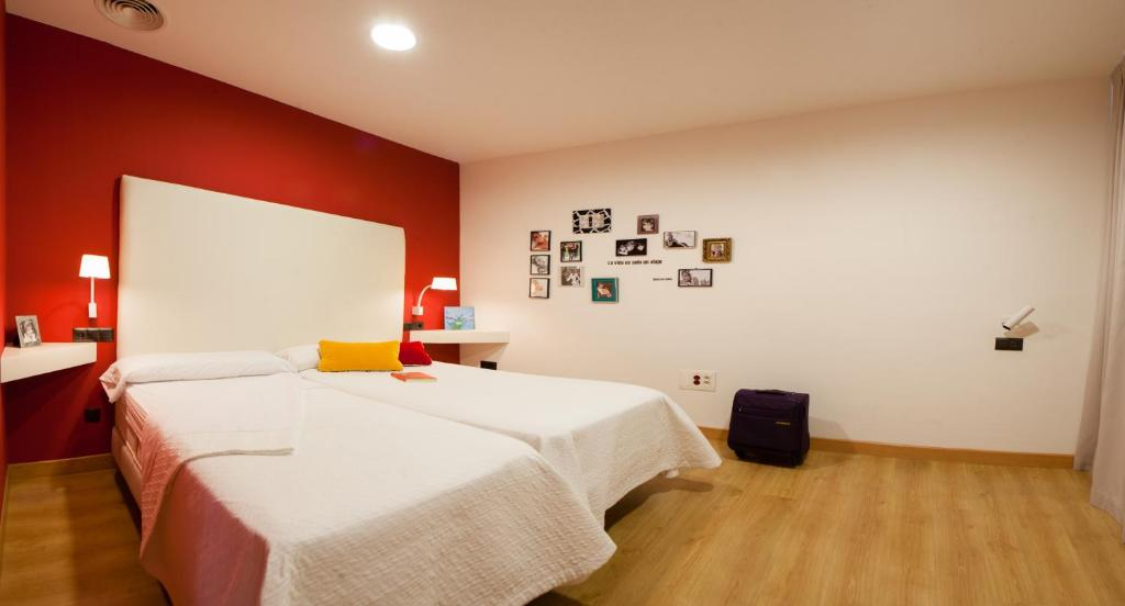 A bed or beds in a room at Ritual Alameda Sevilla