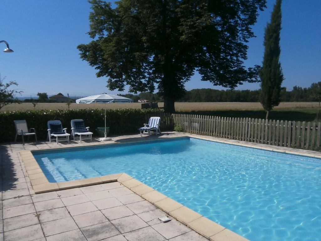 The swimming pool at or near La Ferme Montplaisir