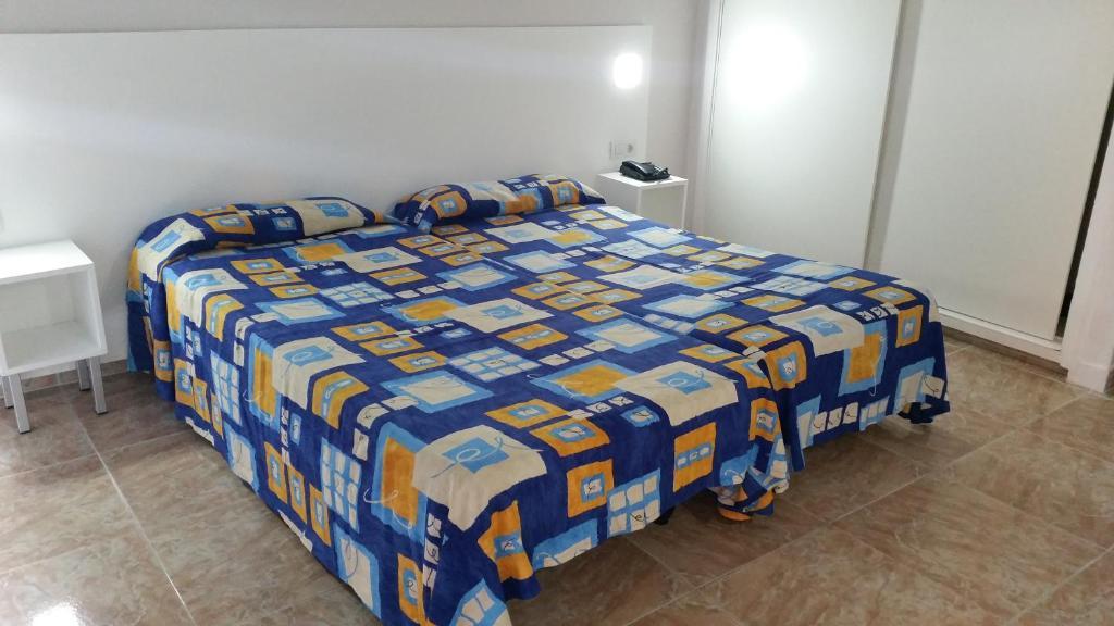 Cama o camas de una habitación en Apartamentos Chinyero