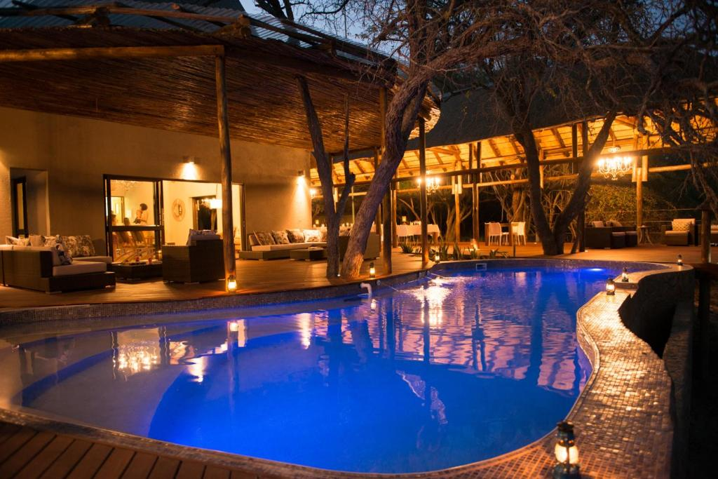 The swimming pool at or near Moditlo River Lodge