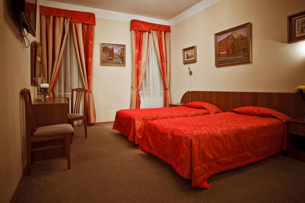 Кровать или кровати в номере Kholstomer