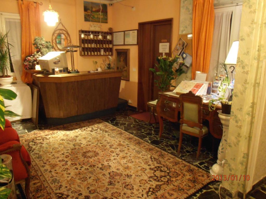 The lobby or reception area at Souvenir Maya