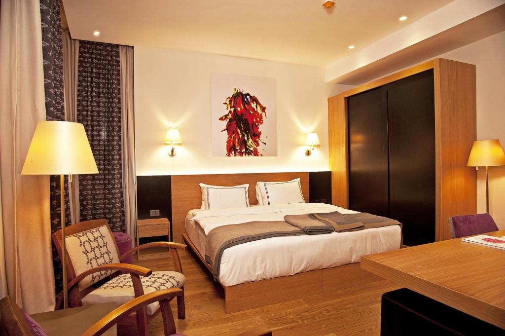 A bed or beds in a room at Misafir Suites 8 Istanbul