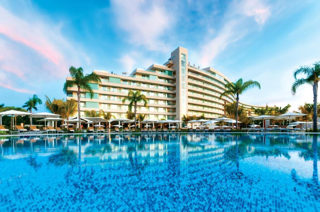 The swimming pool at or near Palacio Mundo Imperial All inclusive hotel