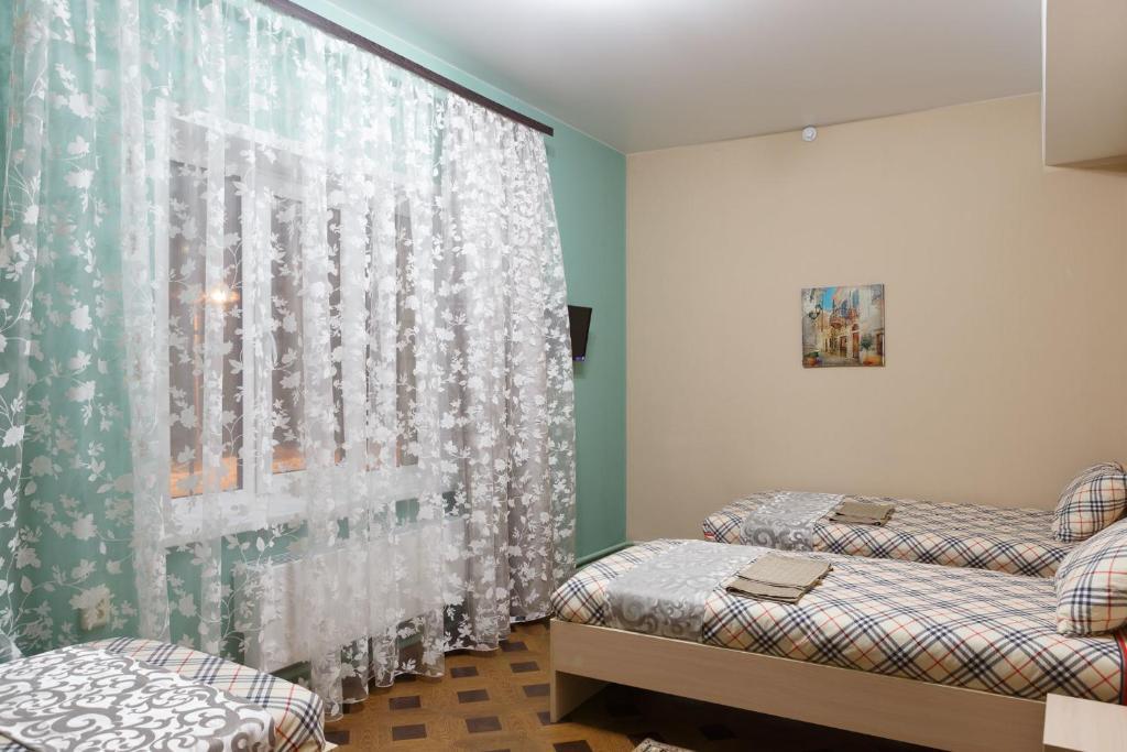 Кровать или кровати в номере Гостиница Верона