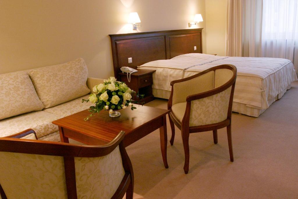 Łóżko lub łóżka w pokoju w obiekcie Hotel Prezydencki 3-star