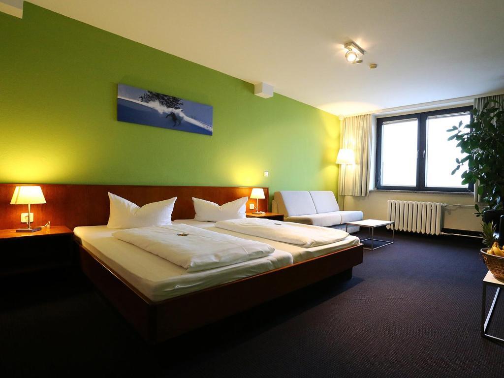 Ein Bett oder Betten in einem Zimmer der Unterkunft k1 sporthotel