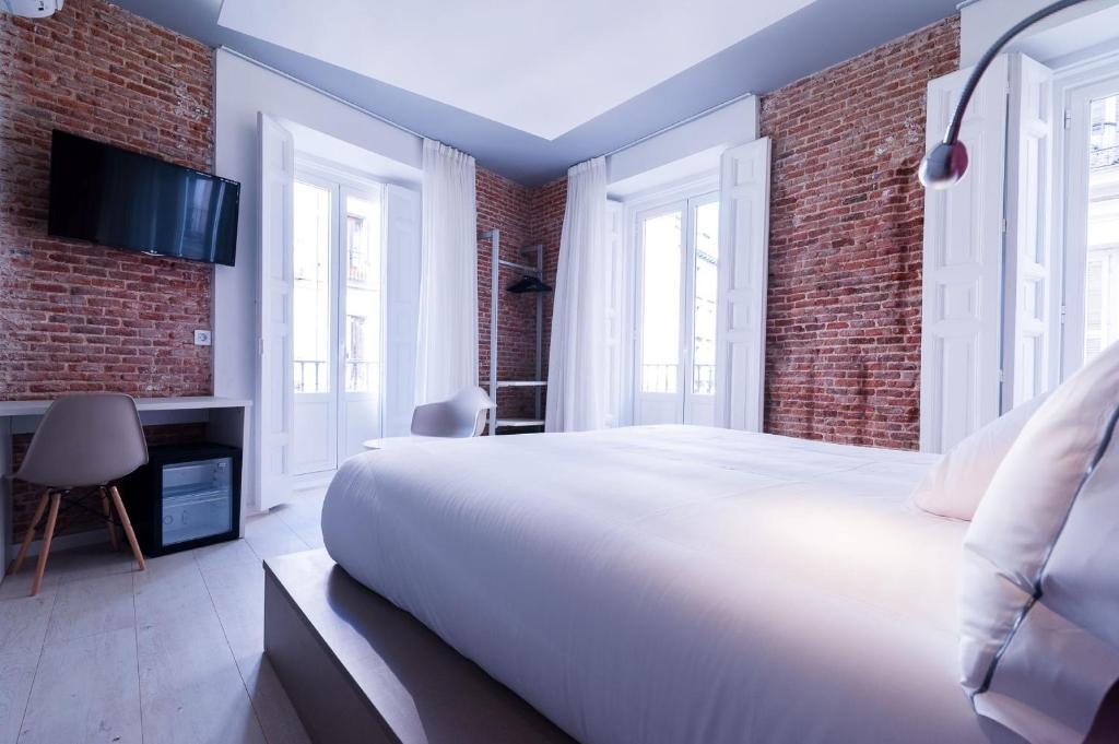 Ein Bett oder Betten in einem Zimmer der Unterkunft B&B Hotel Madrid Centro Fuencarral 52