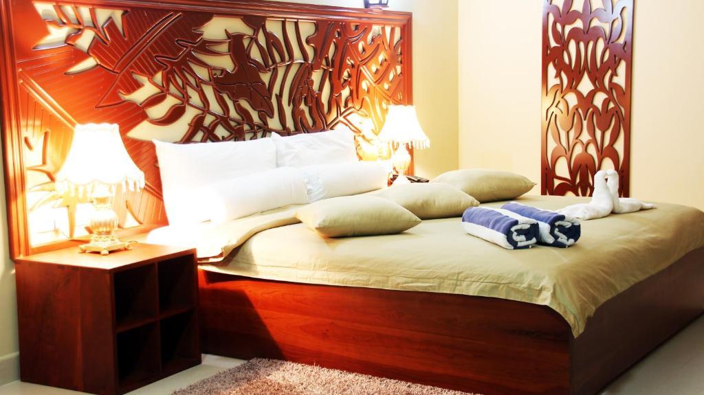 Кровать или кровати в номере Pirogue Lodge