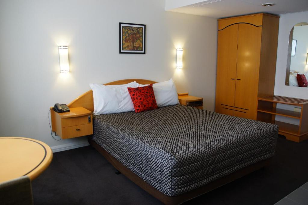 A bed or beds in a room at Morgans Boutique Hotel