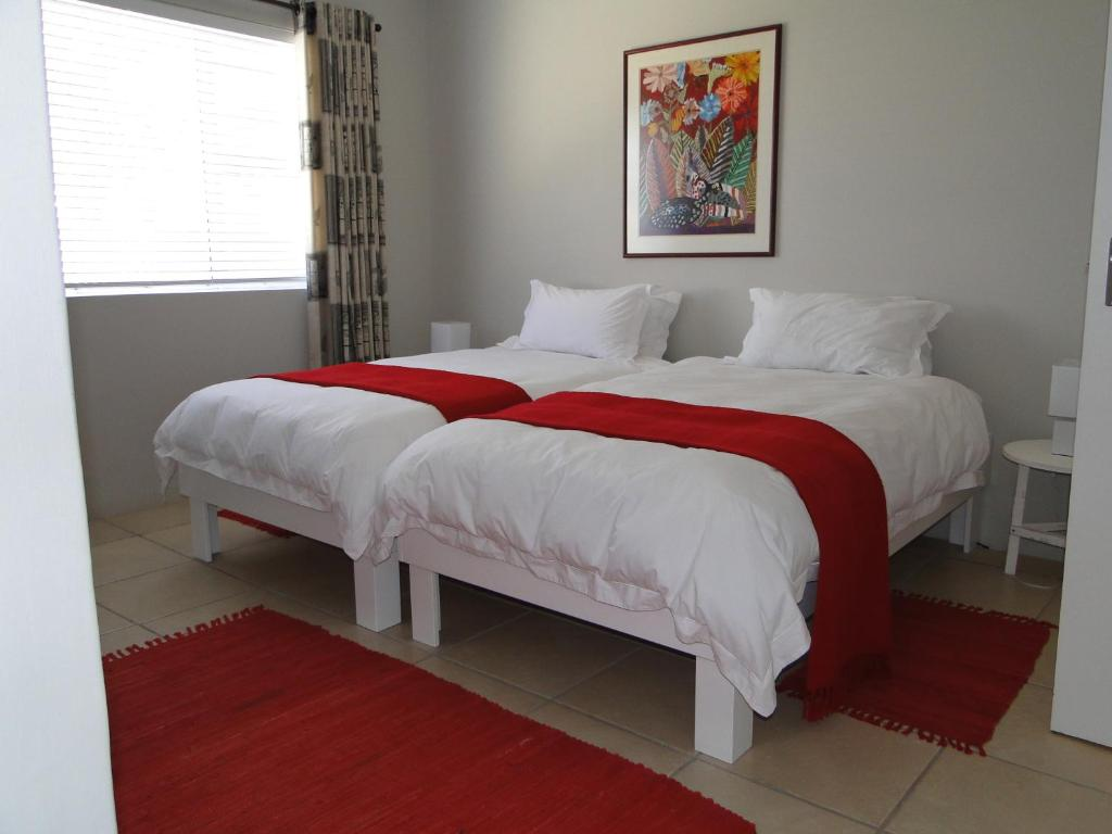 A bed or beds in a room at Our Nest Guest House