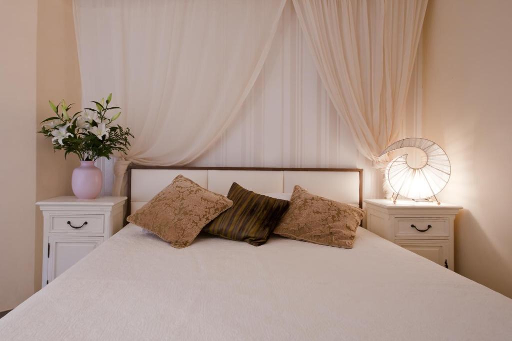 Ένα ή περισσότερα κρεβάτια σε δωμάτιο στο Polydor
