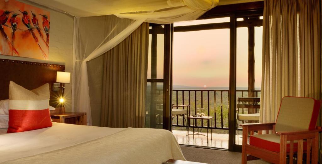 Un ou plusieurs lits dans un hébergement de l'établissement Victoria Falls Safari Lodge