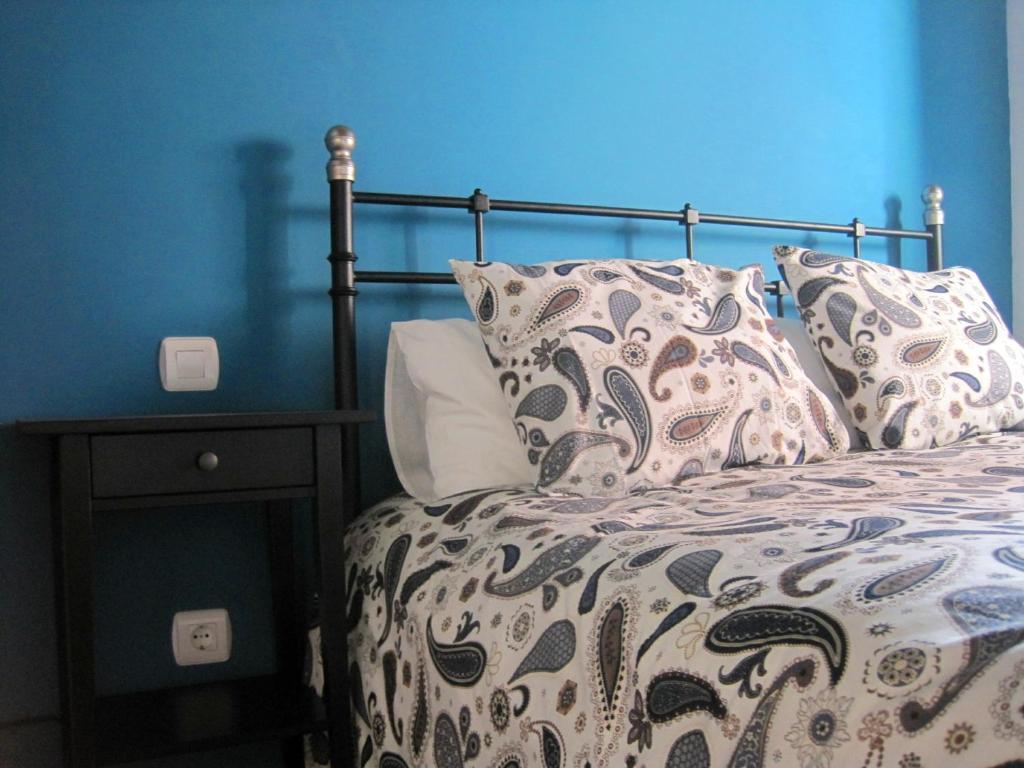 Cama o camas de una habitación en La Casina de Piedra ENCANTO