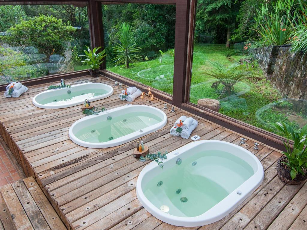 Um banheiro em Pousada Jardim das Montanhas