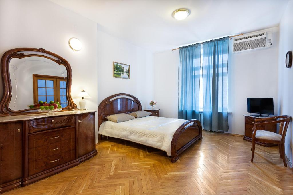 A bed or beds in a room at Kruazi on Kutuzovsky