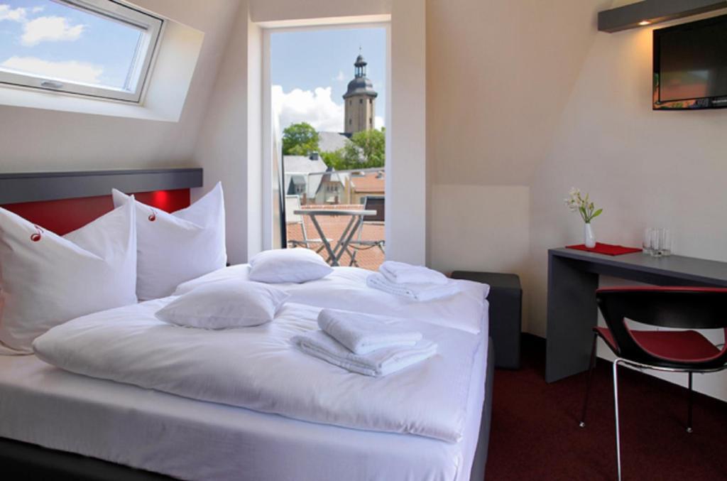 Ein Bett oder Betten in einem Zimmer der Unterkunft Hotel VielHarmonie
