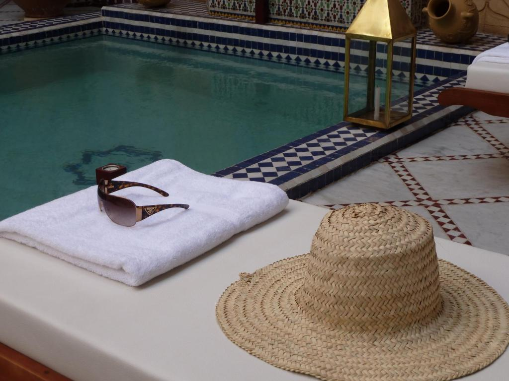 The swimming pool at or near Le Pavillon Oriental