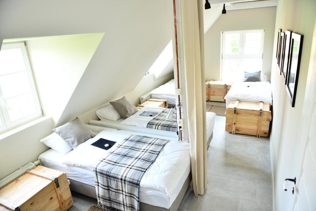 Łóżko lub łóżka w pokoju w obiekcie Five Point Hostel & Apartments