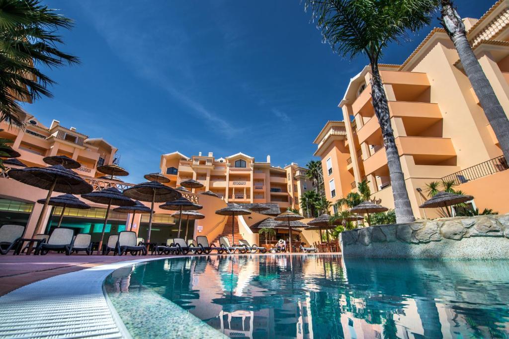 The swimming pool at or near Estrela da Luz Resort