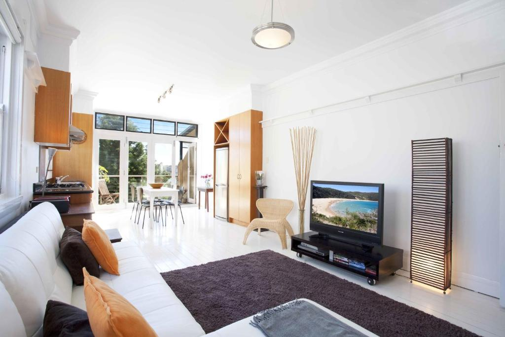A television and/or entertainment center at Bondi Beach Breeze - A Bondi Beach Holiday Home