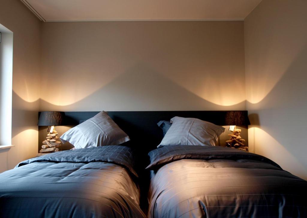 Ліжко або ліжка в номері Private House