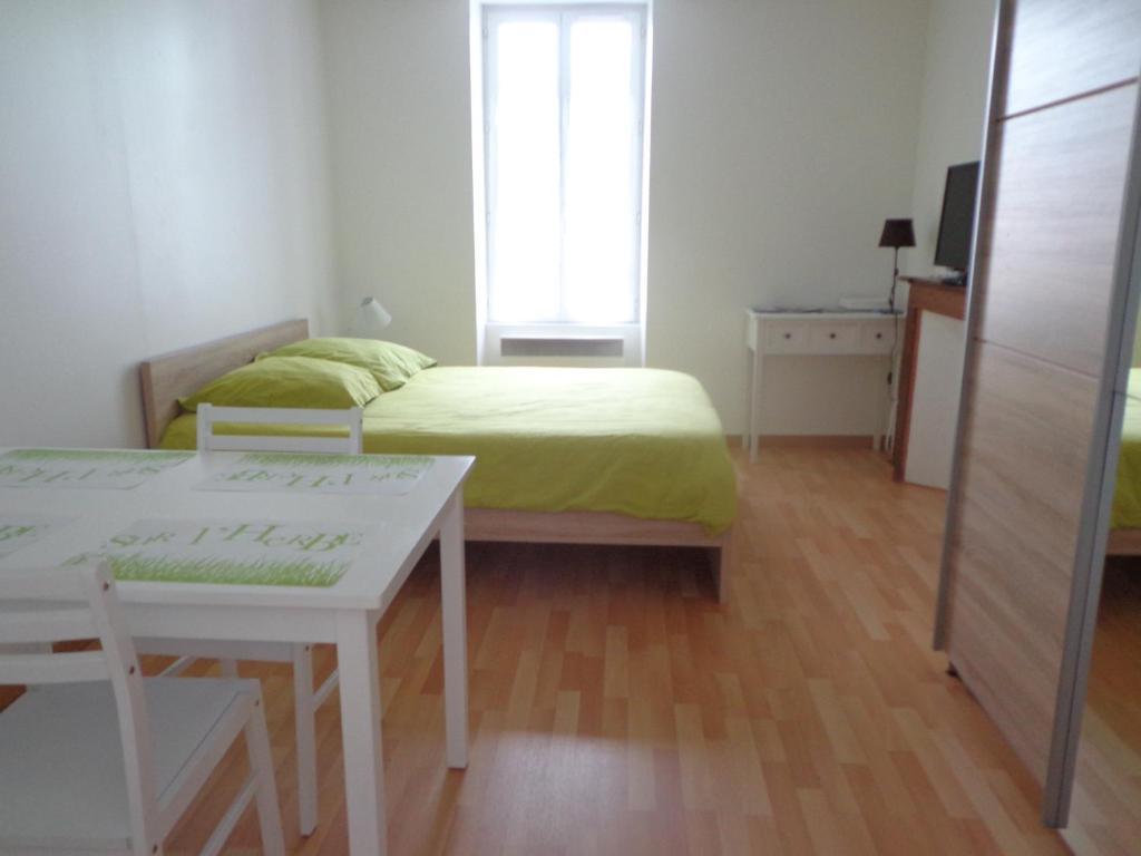 Un ou plusieurs lits dans un hébergement de l'établissement Appartement d'Hôtes
