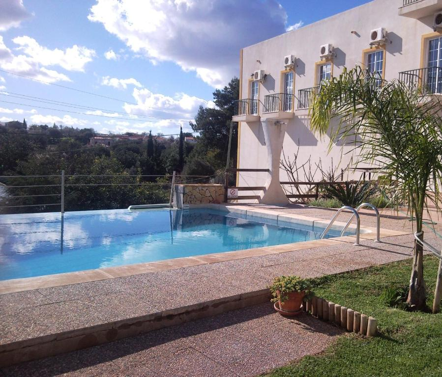 The swimming pool at or near Golda Sol