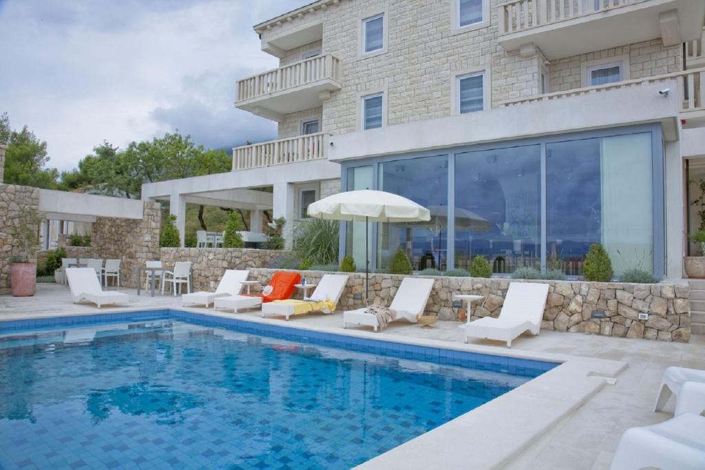 Bazén v ubytování Villa Dalmatina - Adults Only nebo v jeho okolí