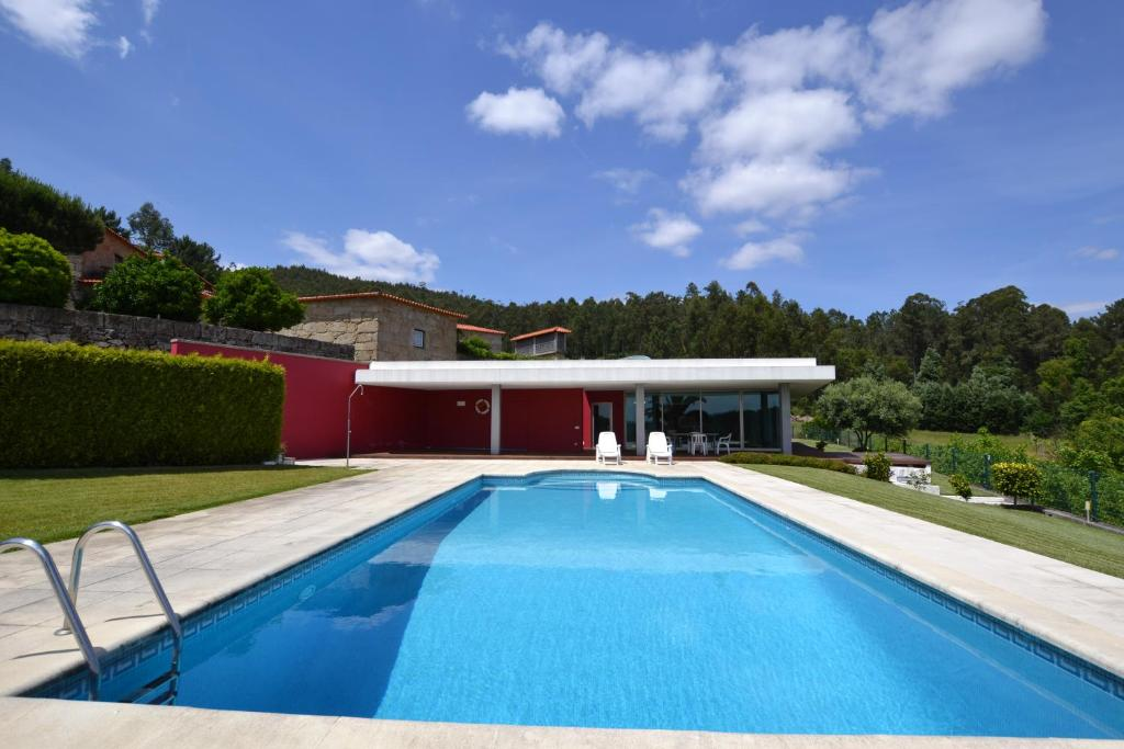 The swimming pool at or near Quinta do Sourinho