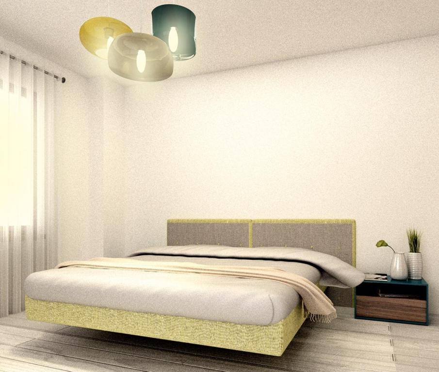 Un pat sau paturi într-o cameră la Apartament Deluxe Solid Mamaia