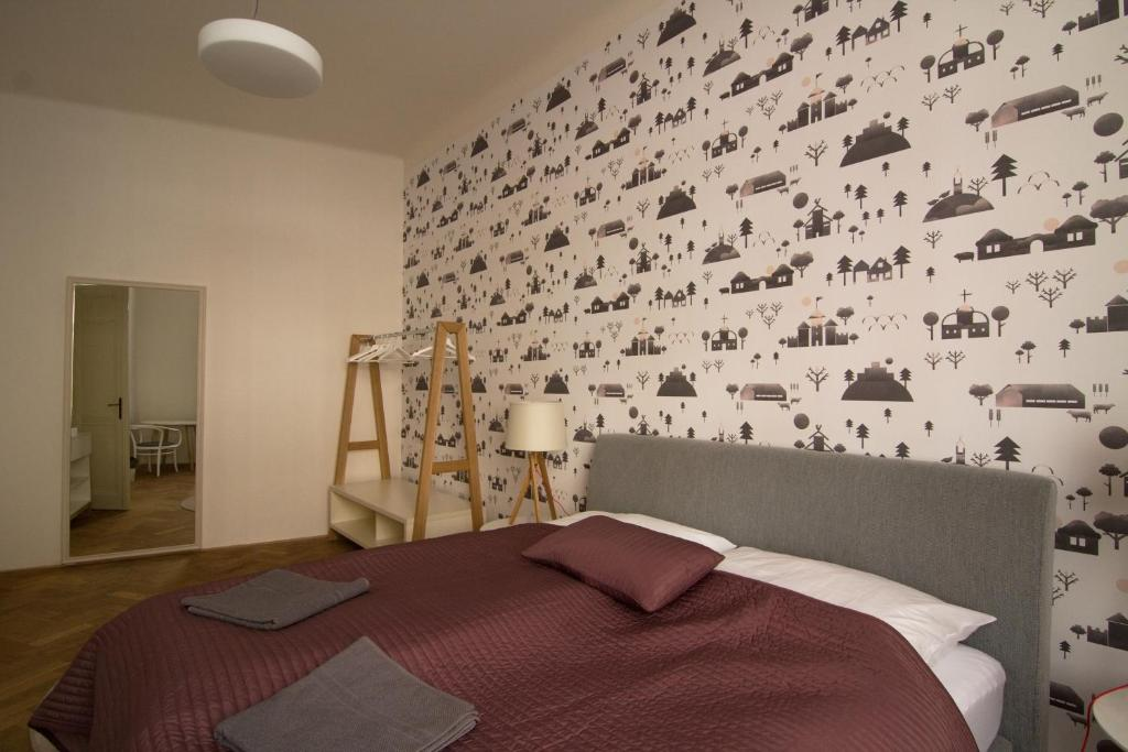 A bed or beds in a room at Best Place in Prague