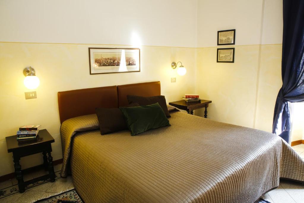 Un ou plusieurs lits dans un hébergement de l'établissement Albergo Garisenda
