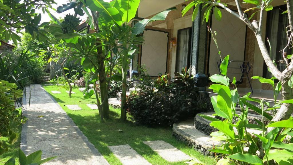 A garden outside Seahua Ha Ha Tulamben Dive Resort
