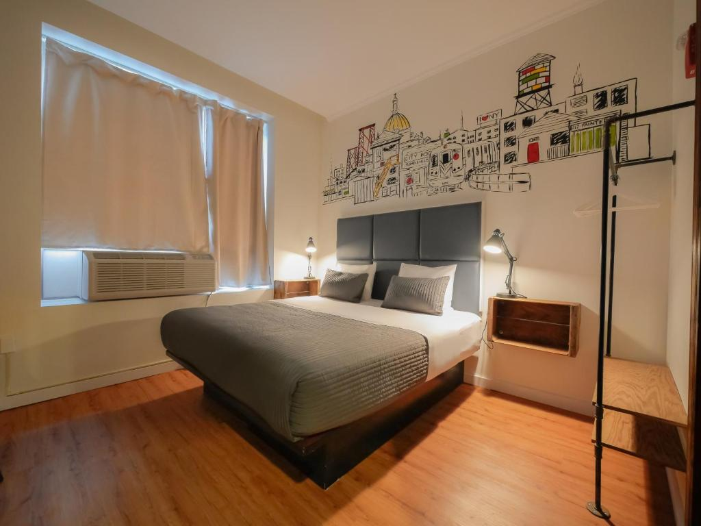 A bed or beds in a room at CITY ROOMS NYC - Soho