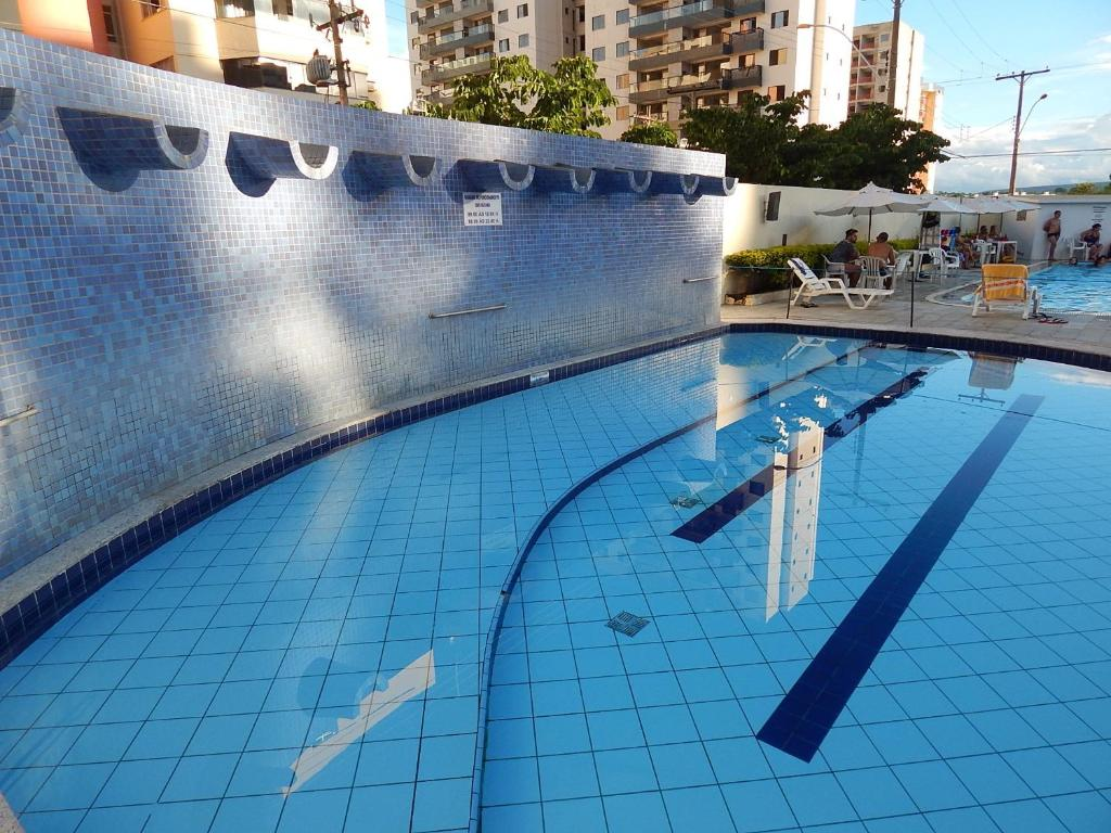 The swimming pool at or near Flat Eldorado Thermas Park