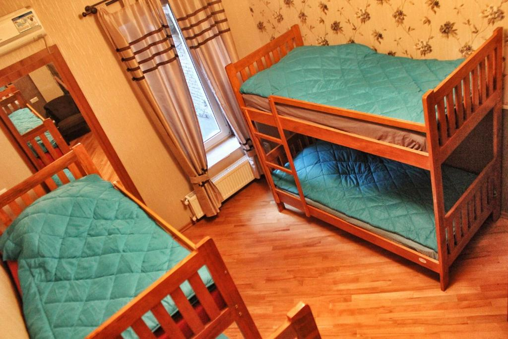 A bunk bed or bunk beds in a room at Nest Hostel Tbilisi