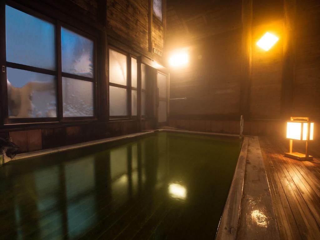 The swimming pool at or near Kumanoyu Hotel