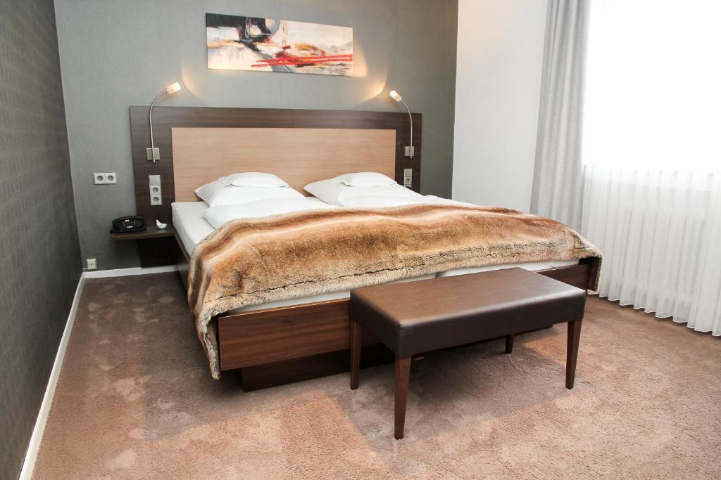 Ein Bett oder Betten in einem Zimmer der Unterkunft Hotel Vetter