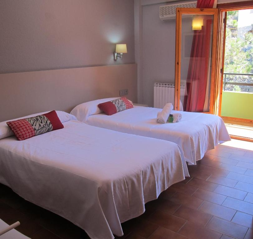 A bed or beds in a room at Hotel Meson de L'Ainsa