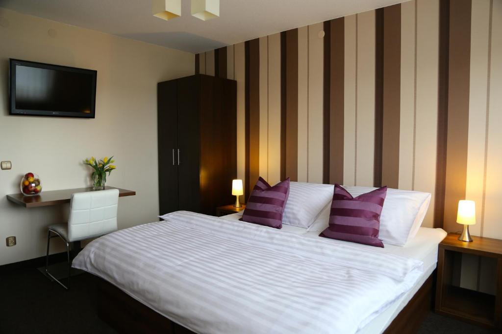 Łóżko lub łóżka w pokoju w obiekcie 10 Bed And Breakfast