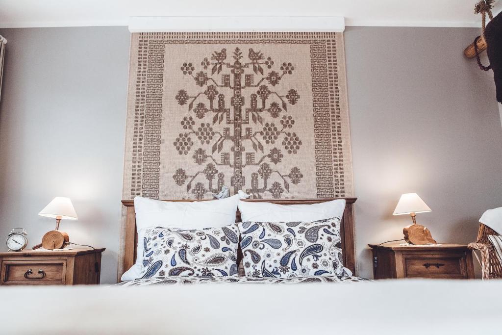 Łóżko lub łóżka w pokoju w obiekcie Willa Hamry